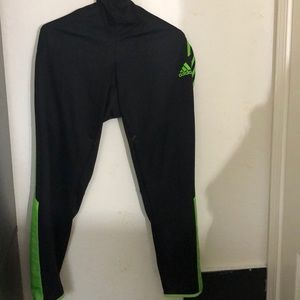 Adidas soccer sweats with neon green stripes